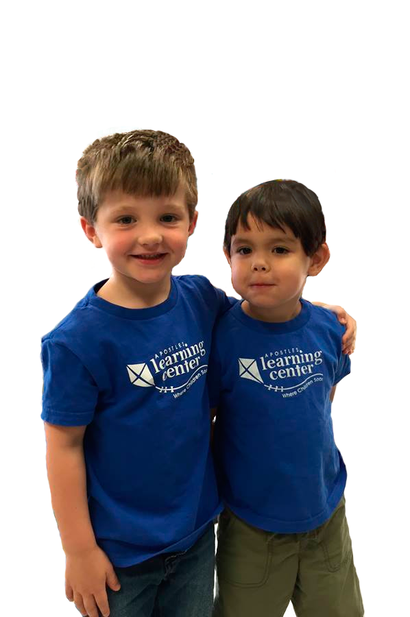 Two boys standing together Apostles Learning Center